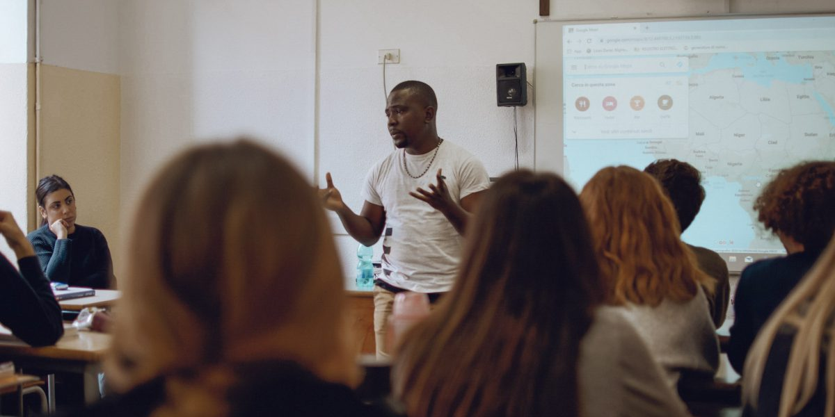 A migrant from Cameroon gives a talk in an Italian school to break down barriers.