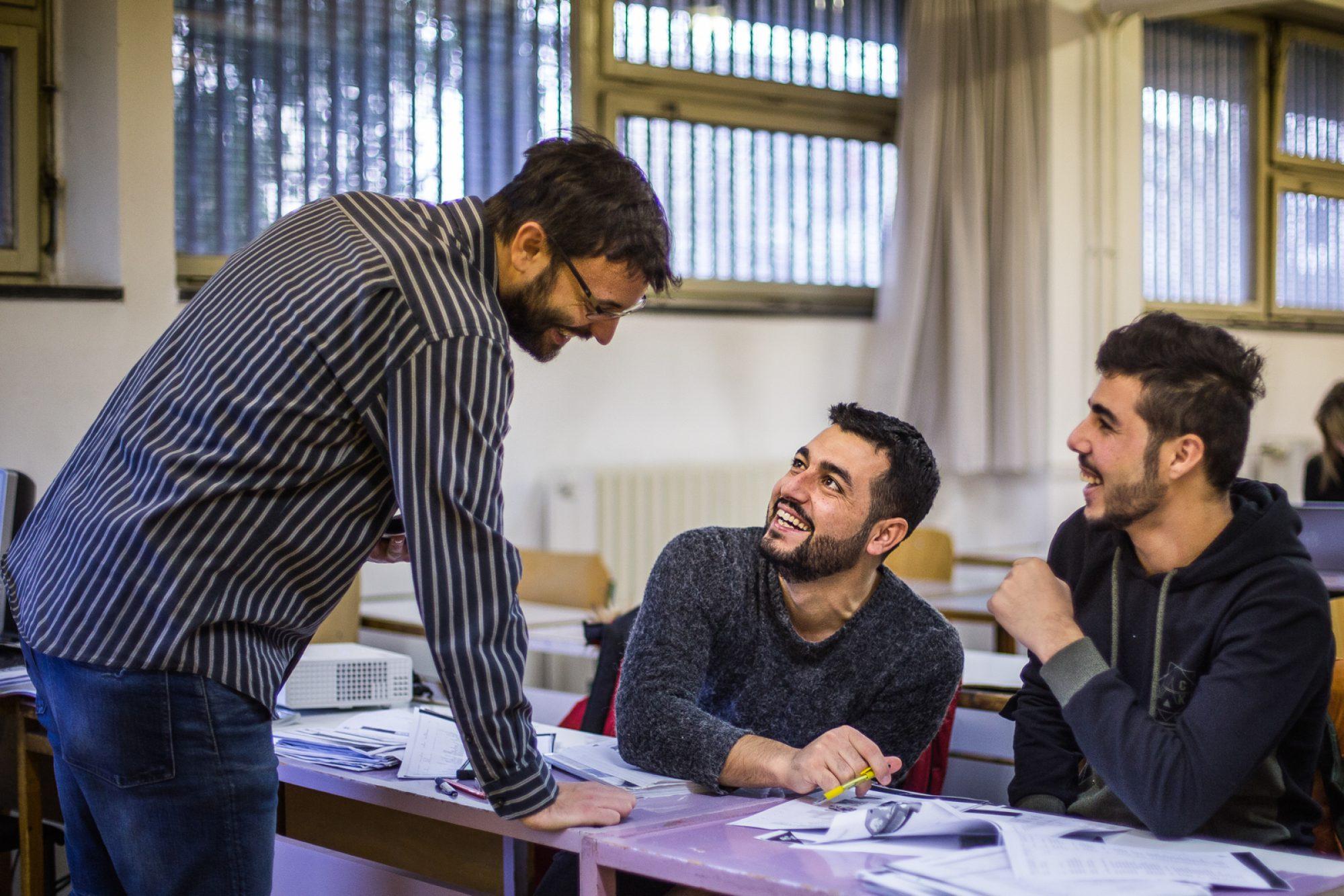 A Croatian language teacher speaks with two asylum seeker students in a class in Zagreb.